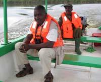 Hassan Mutebi and a Lake Mburo park ranger. Photo by © 2006, Chuck Hagner/Birder's World magazine