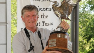Clay Taylor, naturalist market manager of Swarovski Optik North America, holds the trophy for winning the Adult Weeklong Tournament at the 2013 Great Texas Birding Classic. His team, the Swarovski Optik Highway Hawks, identified 330 species in seven days. Photo courtesy Great Texas Birding Classic