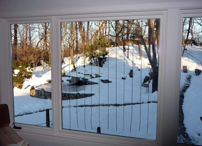 Acopian BirdSavers on a residential picture window. Photo courtesy of Acopian BirdSavers.