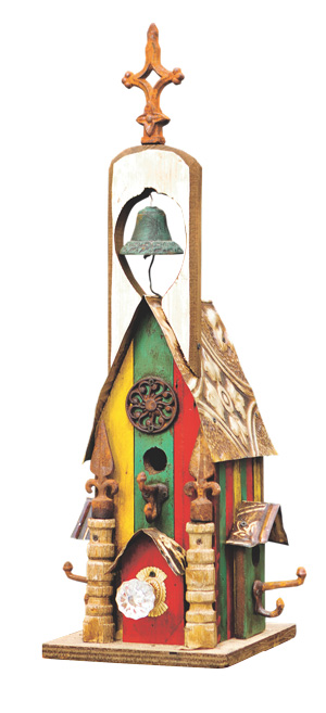 Coat hooks stand in for perches on the gaily colored Single-Bell House by Lorenzo Padilla of Houston, Texas. The birdhouse is featured in a fun new picture book by Anne Schmauss. Jerry B. Smith Photography.