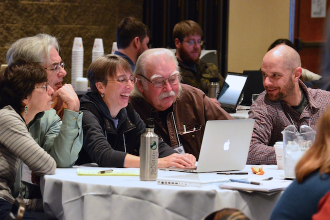 Birders at the kickoff meeting for the second Wisconsin Breeding Bird Atlas look at a laptop while learning how to enter breeding-bird data into eBird. Photo by Florence Edwards-Miller